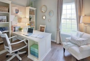 Transitional Home Office with Pottery Barn Cameron Roll Arm Upholstered Armchair, Built-in bookshelf, Hardwood floors