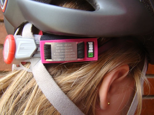 The EZBand Sports ID Adjustable Velcro Model (Pink) on a cycling helmet.
