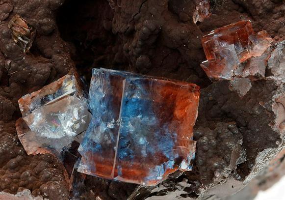 Fluorite on Hematite - Florence Mine, Egremont, Cumbria, England, UK Size: 6.6 × 5.0 × 4.3 cm