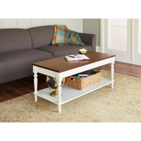 Elevate the look of your space just by swapping old for new with this Isabella Coffee Table. The painted finish is complemented with a wood veneer top, bringing in subtle rusticity that will warm up your room instantly. This traditional coffee table will be right at home in front of your couch, giving you a spot to place things like drinks, snacks and magazines while you're watching your favorite show or enjoying your family's company.