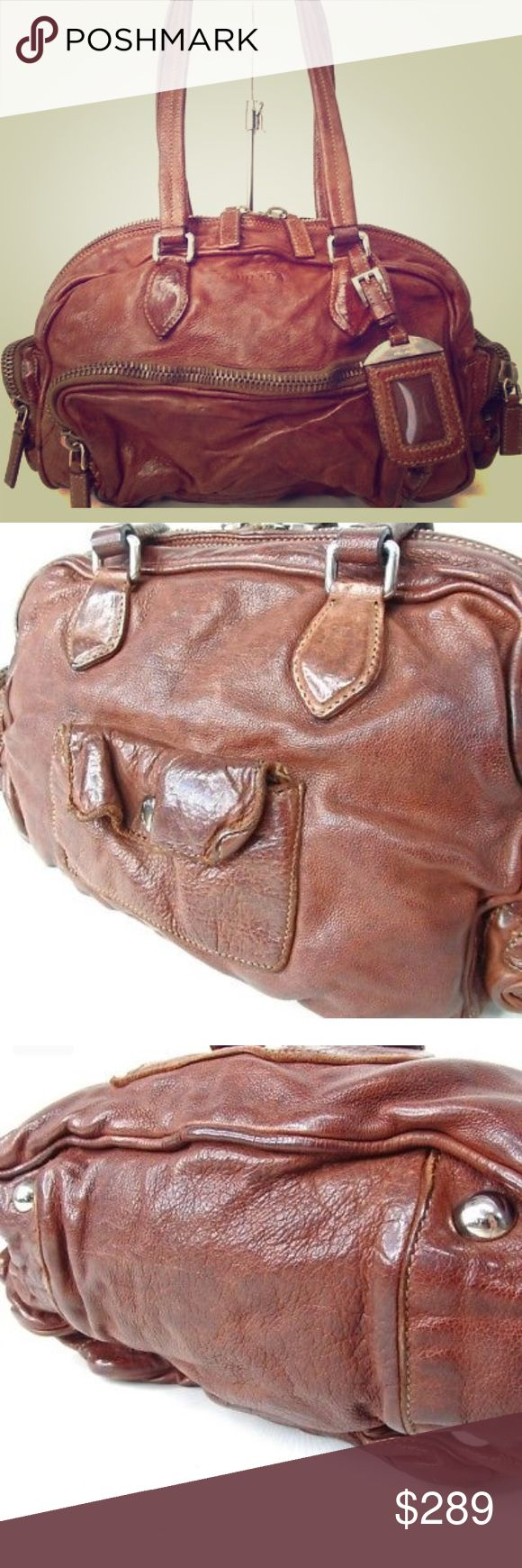 """PRADA leather satchel Guaranteed authentic preowned brown leather PRADA satchel shoulder bag.   Tons of pockets to keep organized.  Overall in good condition, some wear from normal use mostly on corner.  Please see photos before purchasing.   Any offers please use offer option.  Measures 11.75x7x4""""    Bundle to save Prada Bags"""
