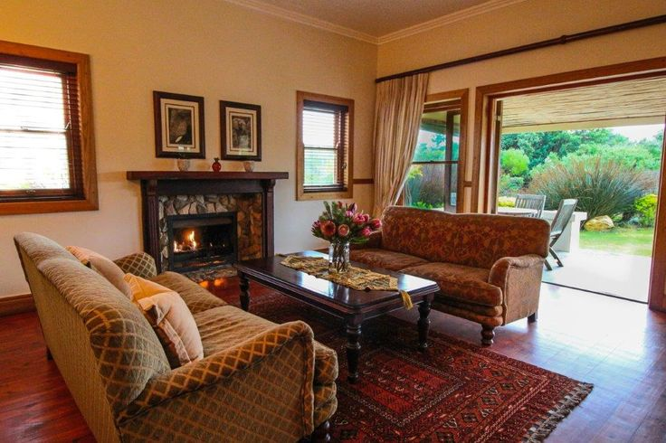 Family cottage lounge with fire and verhanda at Dune Ridge Country House #StFrancisBay #Eastern Cape #SouthAfrica www.duneridgestfrancis.co.za