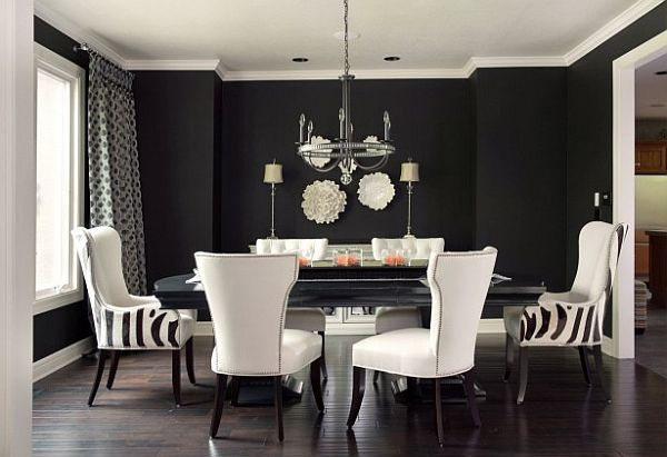 dramatic black white and grey living room decor with striped chairs and large dining table