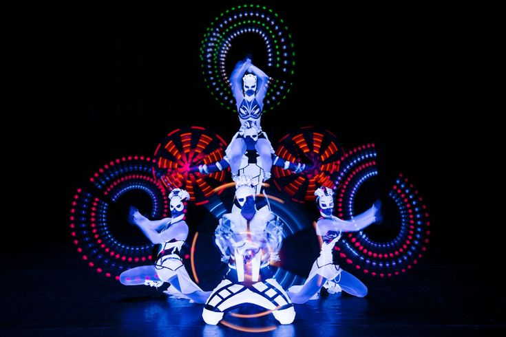 Anta Agni dancers with LED light props, pois and light staffs in black light performance Crystal LIght UV Show. http://antaagni.com/crystal-light-show/