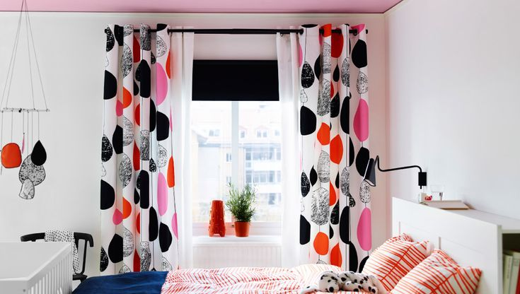 With a blackout roller blind and a thin curtain, you've taken care of practicalities like controlling light and privacy. Choose basic black and white, as they go with anything. Then you can set the style with a bold, patterned curtain – and change it whenever you want.