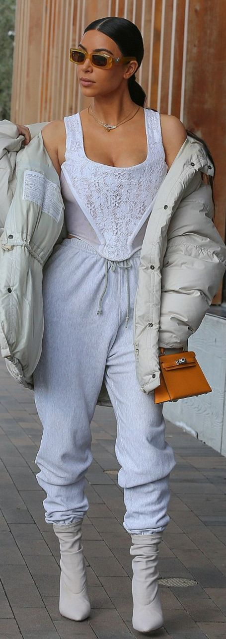 Kim Kardashian in Shirt – Vivienne Westwood  Pants and coat – Yeezy  Purse – Hermes  Sunglasses – Valentino