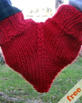 Heart shaped hand holding mitten