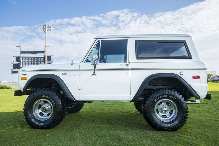 """Side-view of our latest 1974 Classic Ford Bronco restoration w/ 5.0 EFI engine, Bushwacker flares, Clydesdale steering, power front disc brakes, rebuilt Jasper AOD transmission, 2 1/2"""" Suspension lift with 33"""" Procomp tires on new 10"""" rims. Give us a call at 850-434-6769 or e-mail brandon@velocityrestorations.com to inquire more about this beautiful build."""