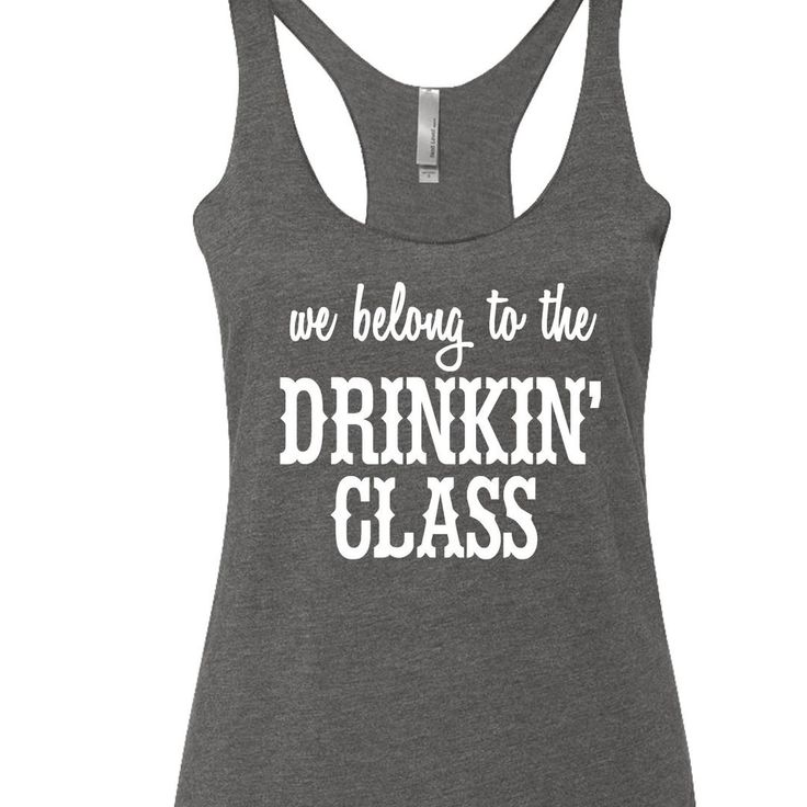 We Belong To The Drinkin' Class printed on a triblend, racerback tank top. These tanks are a mix of cotton and poly, making them super soft and light. This is a relaxed-fit tank that runs true to size