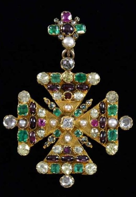An antique gold and gem set Maltese cross pendant, 19th century. Set with diamonds, emeralds, garnets, chrysoberyls and pearls, the reverse engraved with pattern of curling leaves. #antique #pendant