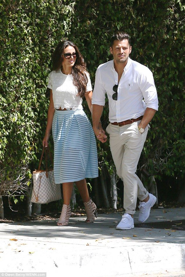 Pastels:The couple coordinated again as they headed to the meeting with Michelle showing off her tiny middle in a white lace crop top paired with a lace, prom-style skirt