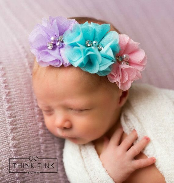 Our unique baby headband features3 pastel organza flowerson a comfortable elastic headband. Each flower is topped with fauxpearls and rhinestones. SHOP newborn headbands at http://thinkpinkbows.com/products/make-believe-floral-headband   Shabby Chic   Baptism   Spring + Summer   Vintage
