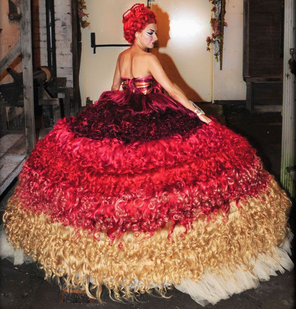 Liverpool dressmaker Thelma Madine has created a dress made entirely from human hair. The size 6 dress, which took eight people over 300 hours to complete, uses 250 metres of hair and weighs 15 stone (95kg). Eight designers from Thelma's dress shop Nico's Dressmakers, which featured on the Channel Four series My Big Fat Gypsy Wedding, spent 12 days making the dress. The dress with a price tag of more than £50,000 includes 1500 crystals and 12 underskirts.