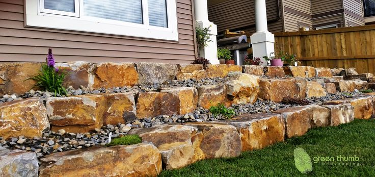 Creating tiers in your retaining wall makes it safer and gives you space to plant shrubs in between the levels. Depending on the size of your project you could also make landings between the tiers.
