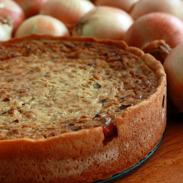 Zwiebelkuchen (German Onion Pie) with bacon, butter and caramelized onions
