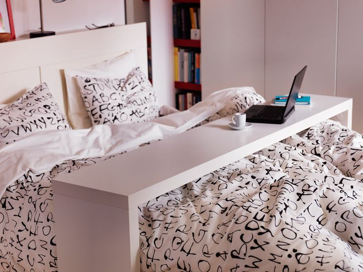 Ikea MALM occasional table. Glides over mattress for working or breakfast in bed!