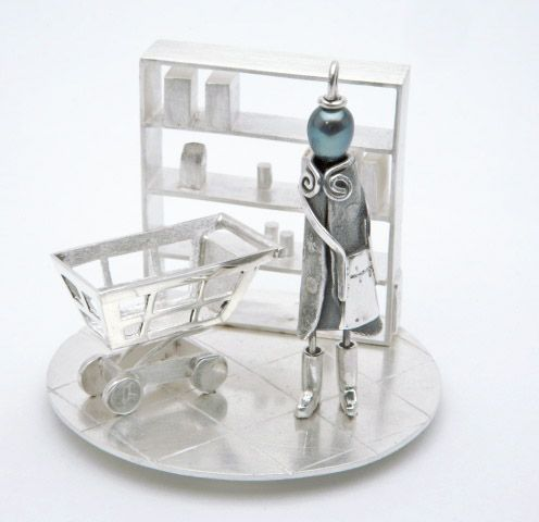 Sterling silver sculpture with pendent Miss Rosie.  Here, Miss Rosie at the grocery store. 53 cm x 6 cm. Sonia Beauchesne Bijoux d'art - Art Jewelry