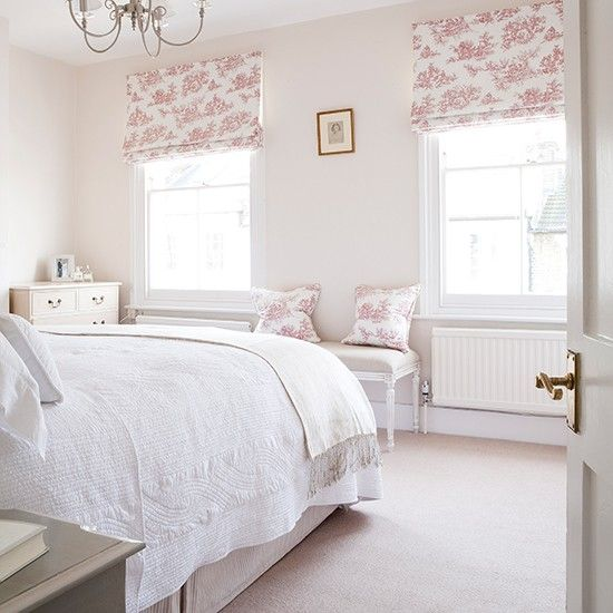 Although the paint in this bedroom is the same as the one in the living room it looks different as a pink toile fabric brings out the warm tones. Roman blinds are a lovely way to show off a beautiful fabric like this one and give a neater finish than roller blinds, as they fold up into pretty pleats & are usually hung from a batten.  Similar fabric, MyFabrics, Bench, The Dormy House.