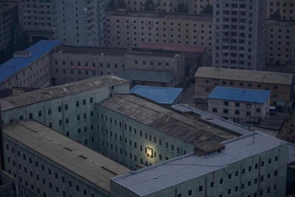 A picture of North Korea's founder Kim Il-sung decorates a building in the capital Pyongyang, October 5, 2011. This photo was awarded first prize in the World Press Photo Daily Life Singles category.     REUTERS/Damir Sagolj
