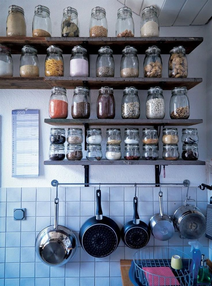 KITCHEN STORAGE. A BUNCH OF GLASS JARS