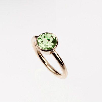 Peridot engagement ring made from rose gold by TorkkeliJewellery, $1219.00