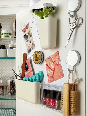 DIY Bathroom Organization Ideas - Mount a magnetic memo board inside a cabinet door to add more storage with magnetic containers via BHG