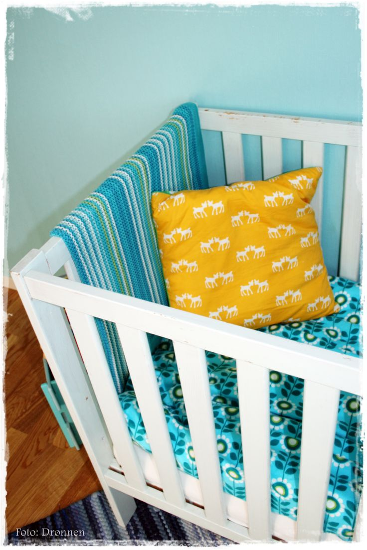 Old crib painted iceblue. Pillow from BLAFRE and homemade covers in flanel.
