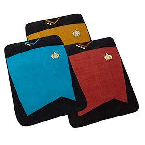 Generously-sized fleece blanket in the style of a Starfleet officer's uniform, so of course you get to choose Command Red, Operations Gold, or Sciences Blue. Make it so, Number 1! So cozy in your quarters, that is.