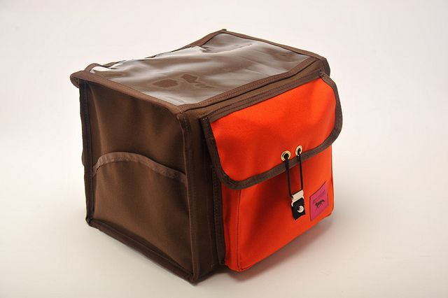 Ozette Rando Bag by Swift Industries -- front handlebar bag with clear sleeve on top and quick release