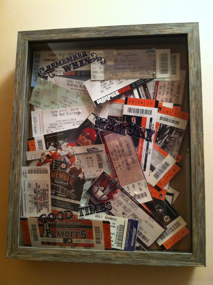 Shadow box with all of the concert tickets and sporting events we have been to since we first got together!