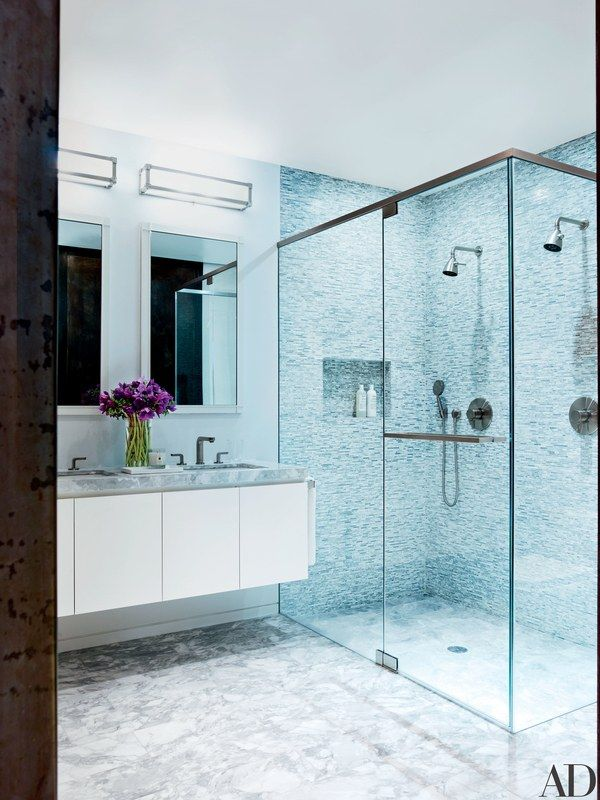 Fixtures by Remains Lighting crown Barbara Barry mirrors for Kallista in the master bath | archdigest.com