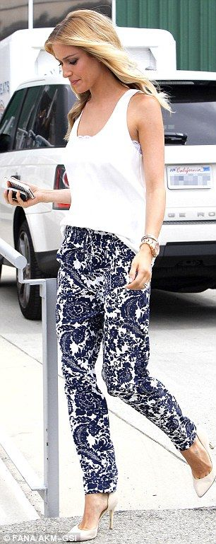 Long show: The 5ft6 reality star displayed her thin pins in a pair of printed trousers