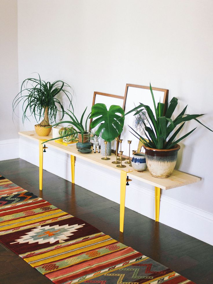 You know I love a good looking bench for piling books, plants, and art.  I've been thinking of a DIY bench idea for our entryway and I  recently discovered The Floyd Leg. They're based in Detroit where they make  these simple legs for building tables. They come in several colors and they  have one in a perfect shade of yellow.  If you've always wanted to add some DIY love in your home, then this is an  excellent project to do because it's the easiest Dab-It-Yourself project  I've ever done…