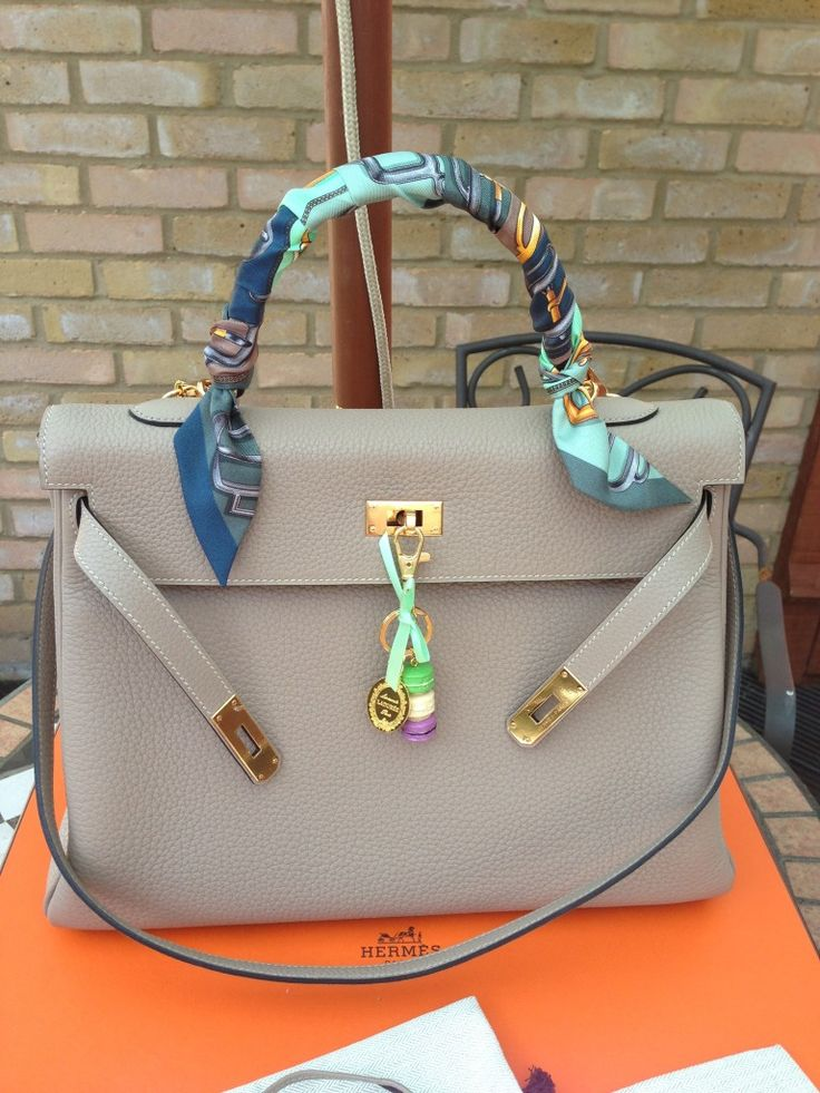 No Hermes for me, but I adore the scarf tied on the handles! Great trend!