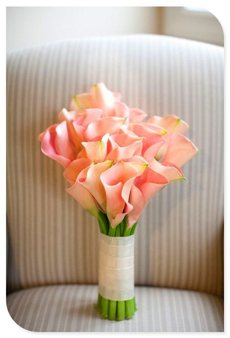 This simple pink cala lily bouquet has a great look for the bridesmaids that won't take away from the bride's bouquet