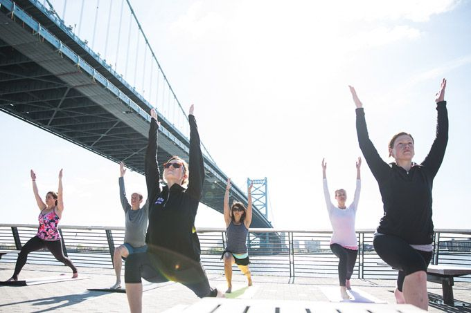 Namaste, Philly. For 2015 spring (and summer and fall!), free yoga classes return to Race Street Pier seven days a week. (Photo by Matt Stanley courtesy DRWC)