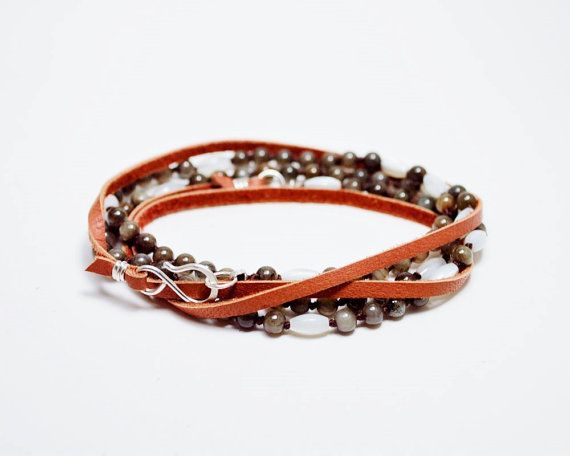 Convertible and stylish.  This necklace is 36 inches long and can be worn several ways.  You can wear it long, as a double strand, or as a wrap bracelet.  It is a great 3 for one deal.  The necklace is hand knotted with mother of pearl and grey agate in a irregular pattern on 100% silk thread.  The rest of the necklace is made of soft deer hide leather in a warm saddle tan with sterling silver accents.  The necklace is finished with a hand formed 925 sterling silver hook clasp…