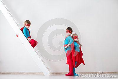 Stock Photo about Kids plays superhero.