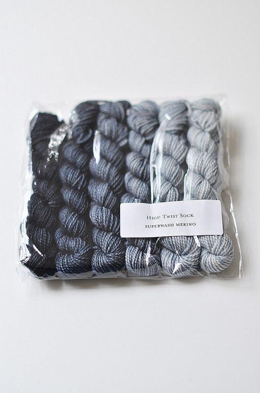Pigeonroof Studios High Twist Sock yarn in a gray gradient.