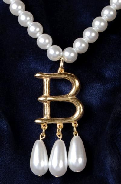 Famous necklace of Anne Boleyn.  She actually had three similar necklaces, one with an A, one with a B, and one with an AB.  It is rumored that her jewels were passed down to Elizabeth I, and also that pearls from Elizabeth I are in the crown of Elizabeth II.  Interesting to think they could possibly be from this legendary necklace.