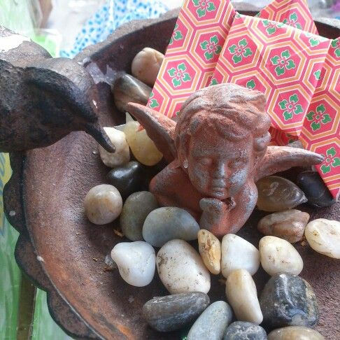 Angel with stones and origami