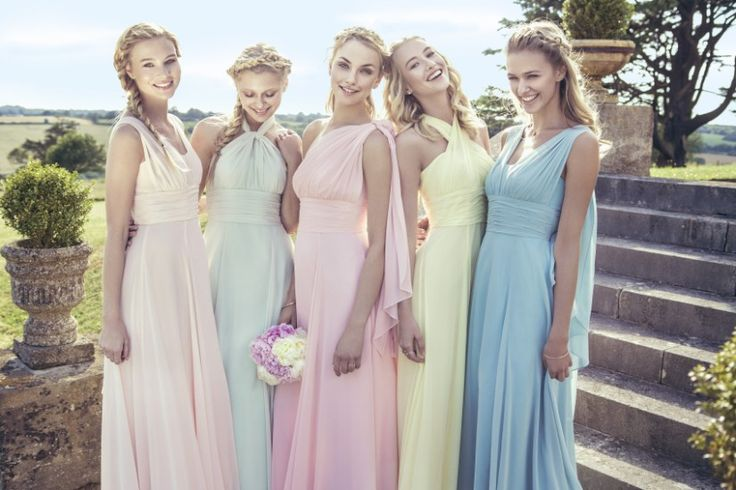 Pale rainbow bridesmaid dresses. Kelsey Rose 2015 #bridesmaid #dresses #pastel #multitonal #pretty #rainbow #peach #pink #blue #green #yellow