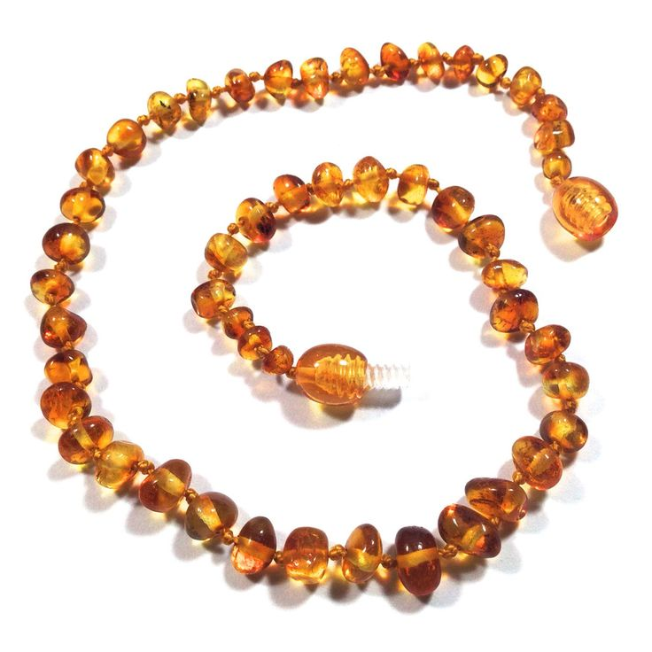 Honey (Economy Price) Baltic Amber Teething Necklace - Effective for teething, drooling, and other pain relief. Must be placed directly on the skin. We recommend moving necklaces to the upper leg during naps and at night for very young children. Baltic amber is meant to be worn, NOT chewed! Made with string knotted between each bead, plastic amber colored twist clasp OR pop clasp. Full-Polish. STRENGTH: 8 out of 10