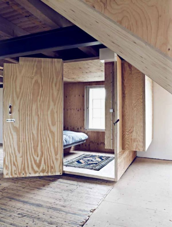 room in room. if it was all painted, this would be a way cute way to turn a huge space/area/room into 2 separate ones without having to split into a separate room. just build a tiny space for a spare guest bedroom or office!