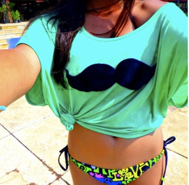Cute neon baiting suit and mustache top.