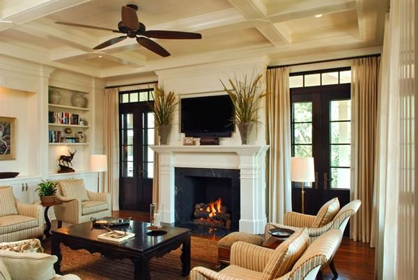Fireplace with French doors to back porch on each side