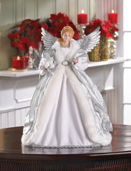 Top your tree with this beautiful angel, decked out in shimmering silver and fur-trimmed robes and glimmering silver wings. She is the perfect finishing touch t