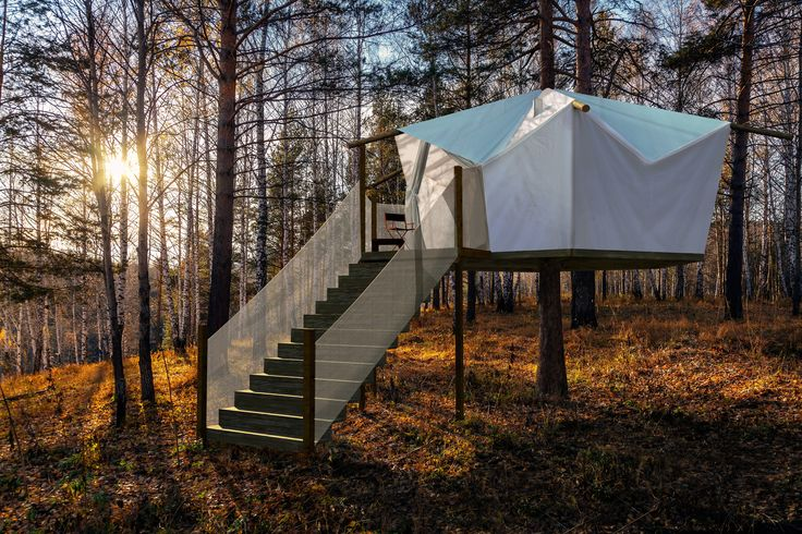 """A luxurious tent in the trees with lots of comfy touches"