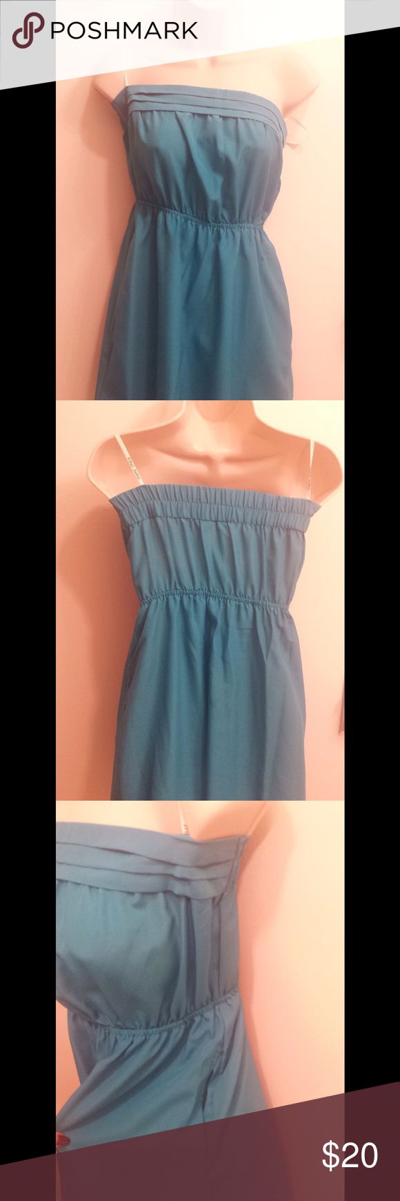 Cute blueish teal strapless summer dress Cute blueish teal summer dress. Strapless with pockets on each side. Elastic around the waist area. Pleated top around the breast area,elastic on the back top area of breast. Has an under layer of cloth. Small stain in the front & back, (from ironing accident) not too noticeable. Pics upon request Mimi Chica Dresses Strapless