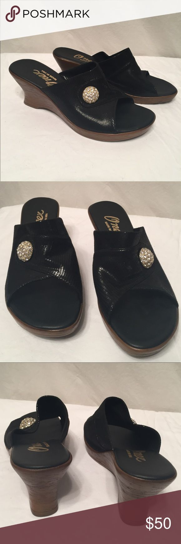 "Stunning Onex sandals. Selling a stunning pair of Onex bling slip on wedge sandals. Made in USA. Sz 8.5. Shiny black fabric. 2.3/4"" heel. Soft foot cushion. Bling button on top exc cond  smoke free home Onex Shoes Wedges"